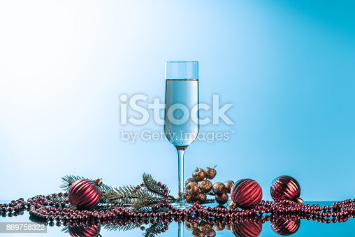 1144550840 istock photo Glass of champagne on neon background. 869758322