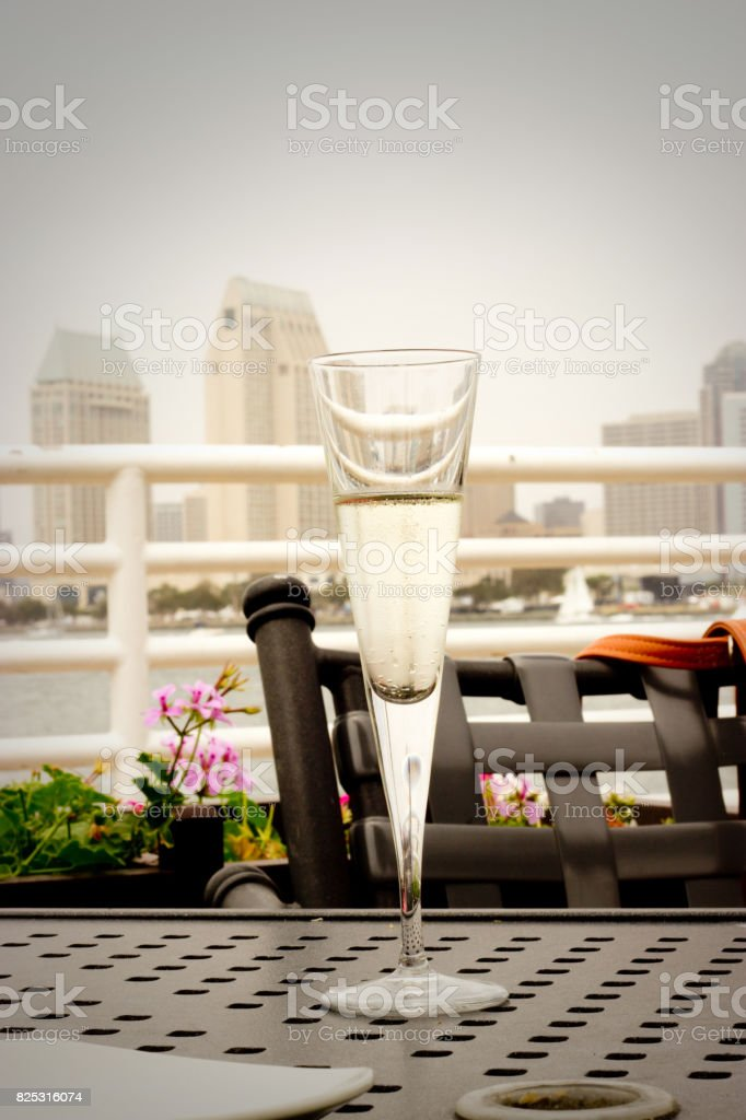 Glass of champagne with a city view stock photo