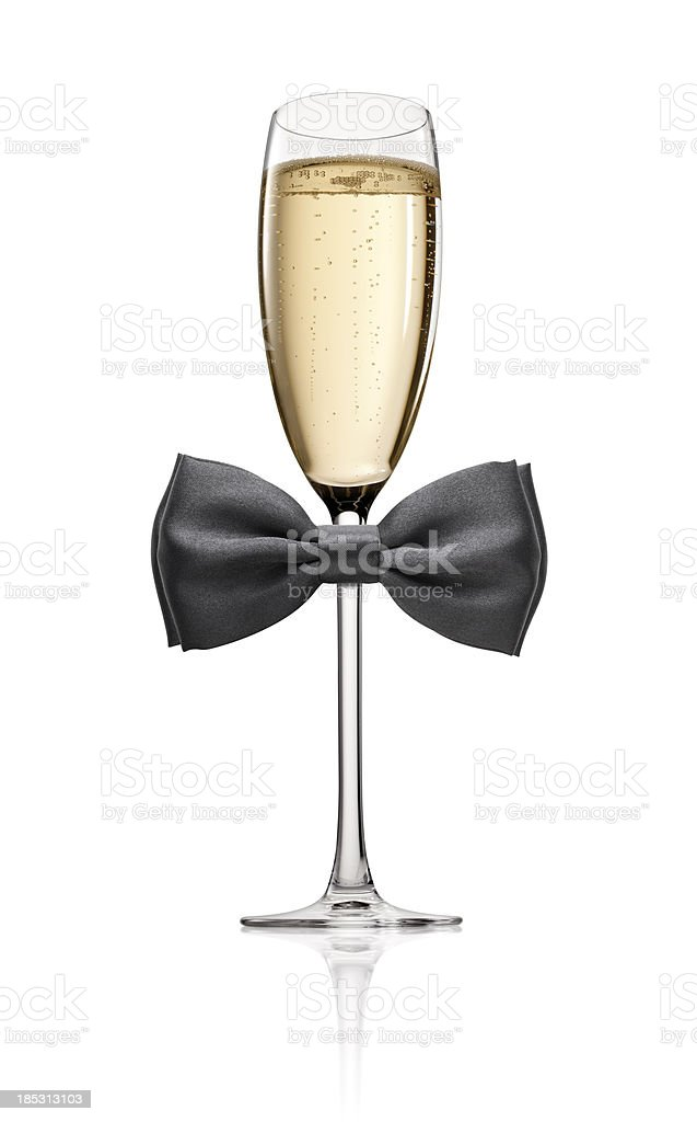 Glass of Champagne with bow tie stock photo