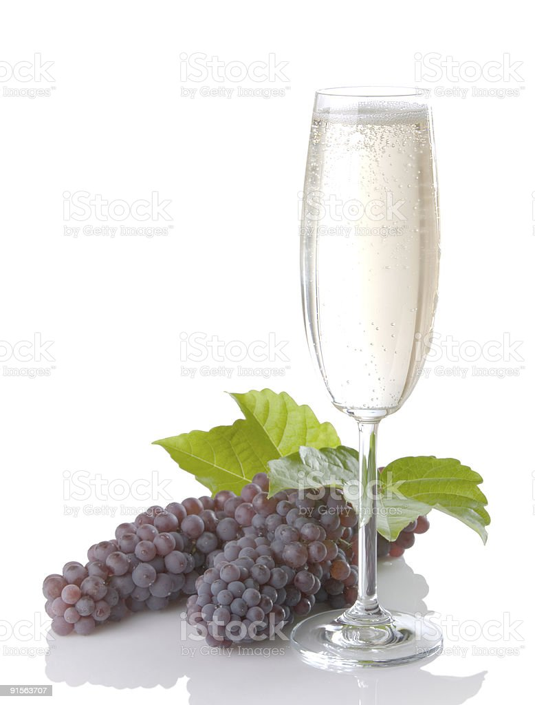 Glass Of Champagne With Grapes And Leaves stock photo