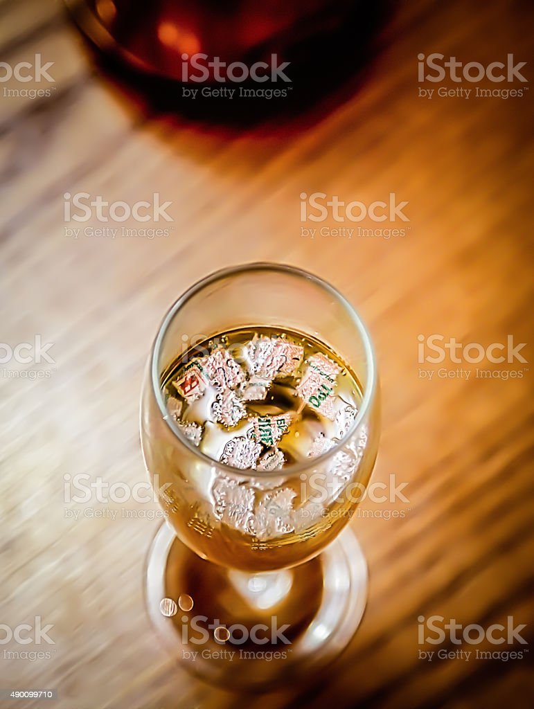 Glass of champagne with ripped lucky ticket stock photo