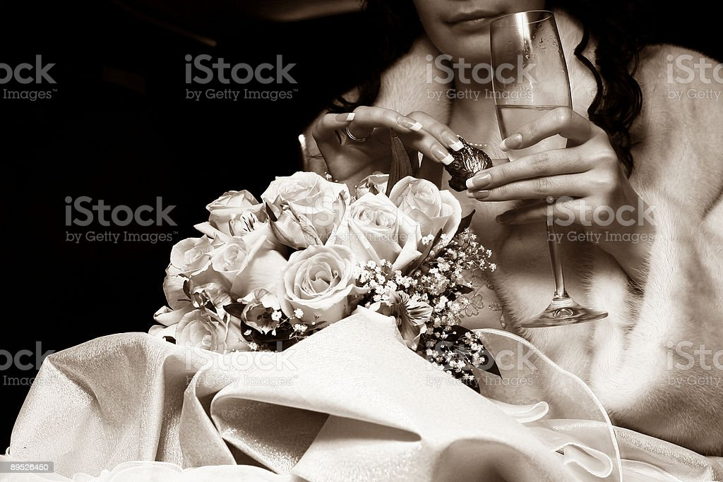 Glass of champaign and a candy for the bride royalty-free stock photo