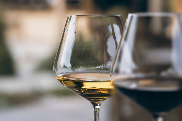 glass of chardonnay white wine close up - wine glass stock photos and pictures