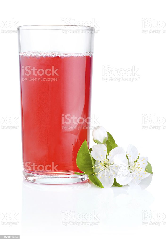 Glass of cherry juice and flowers isolated on white background royalty-free stock photo