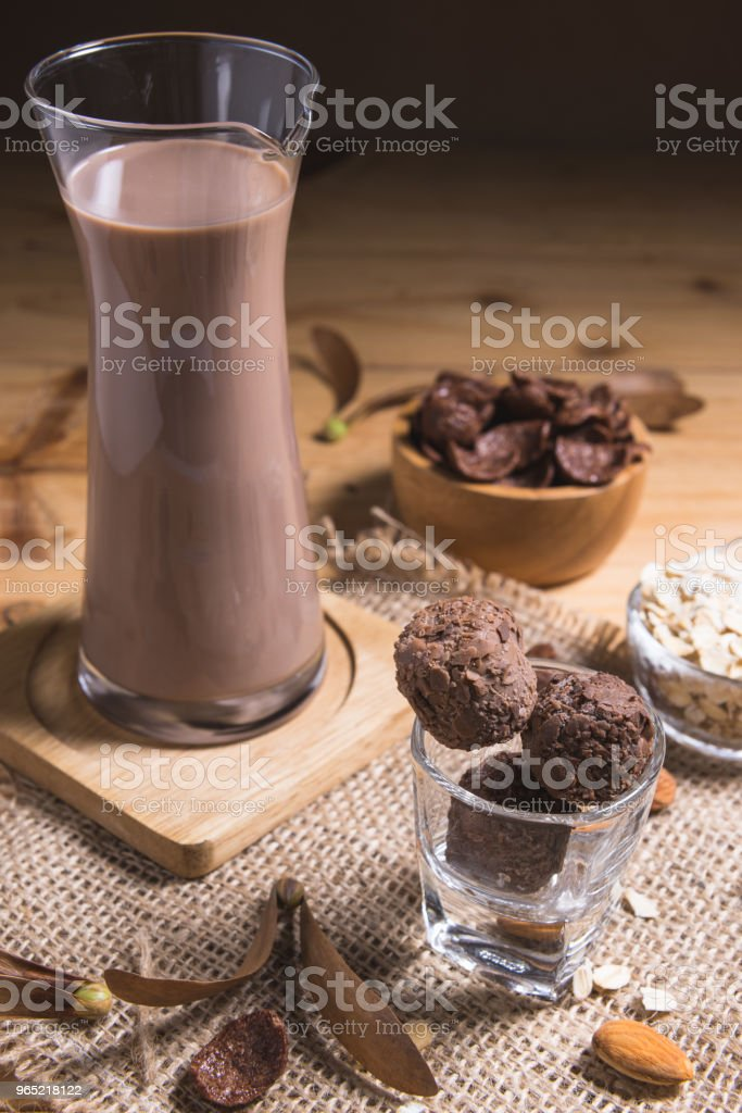 Glass of chocolate milk on table zbiór zdjęć royalty-free