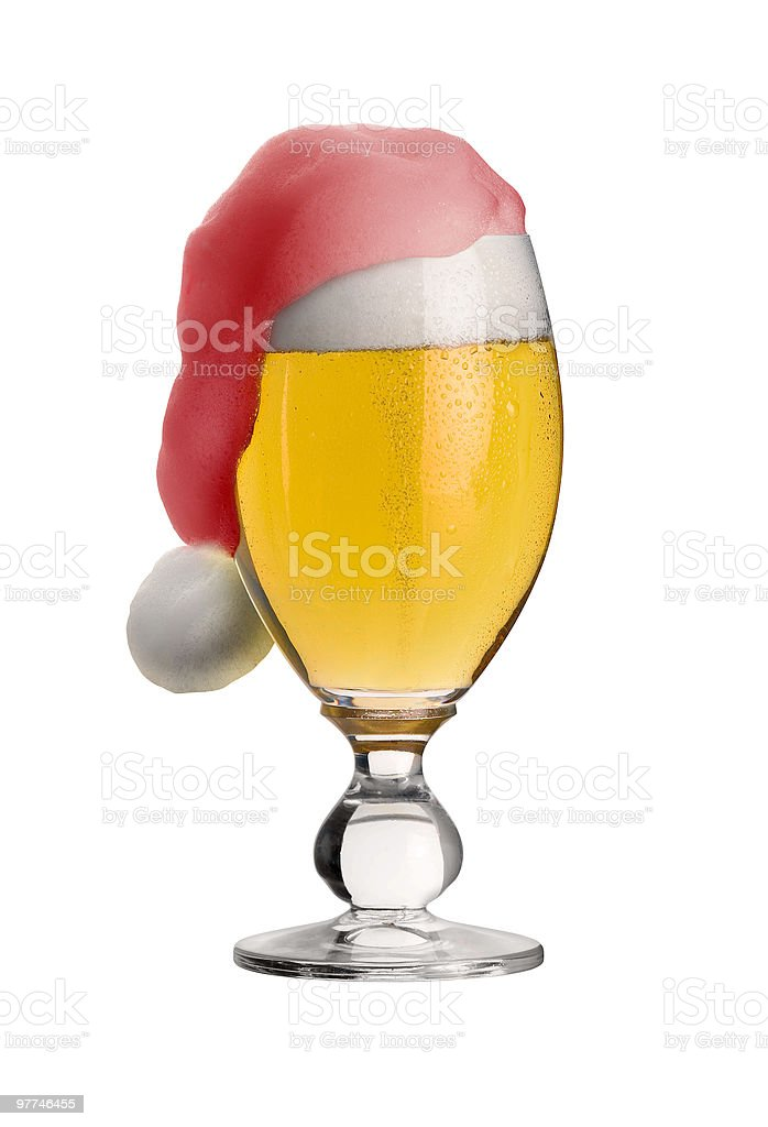 glass of christmas beer with jelly back cap royalty-free stock photo