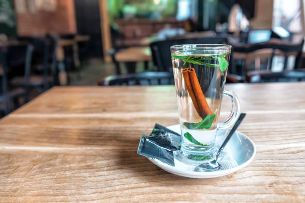glass of cinnamon tea with mint stock photo