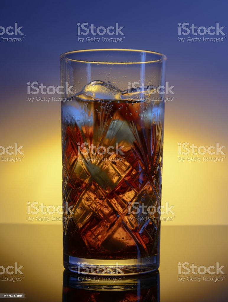 Glass of cocktail and ice royalty-free stock photo