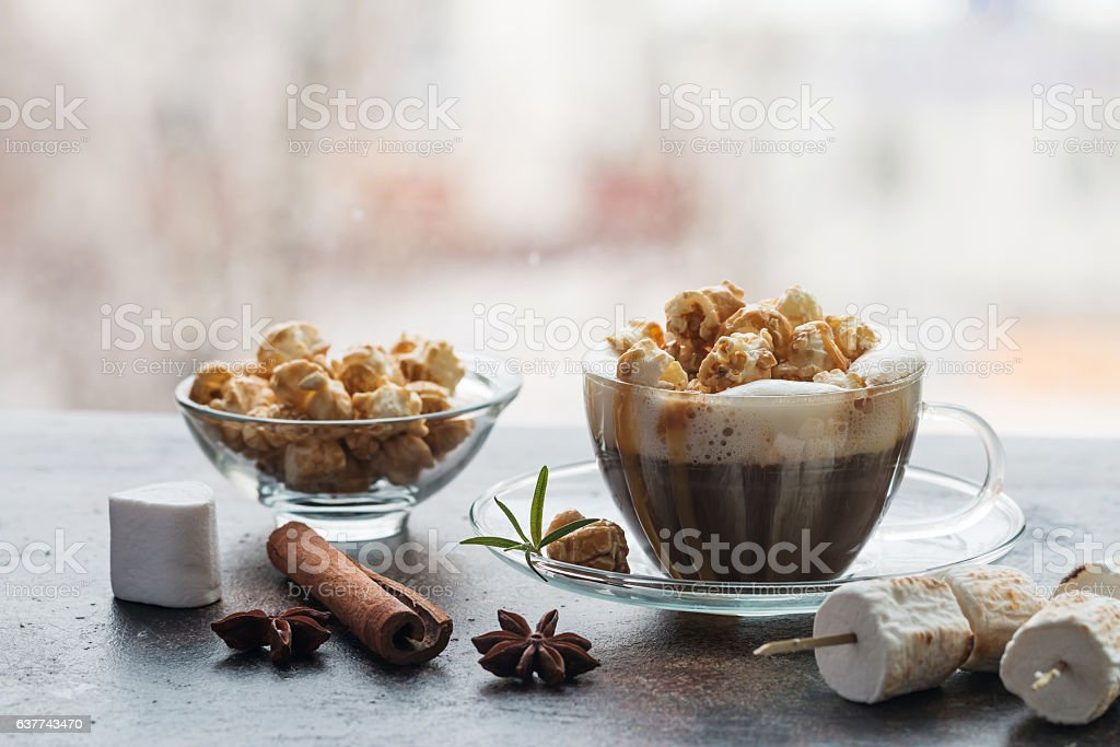 Glass of coffee with popcorn stock photo