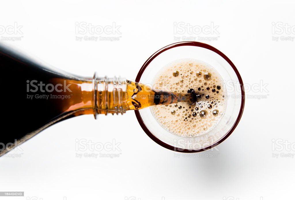 A glass of cola being poured into a glass stock photo