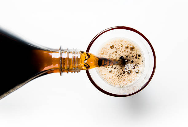 a glass of cola being poured into a glass - soda pop stock photos and pictures