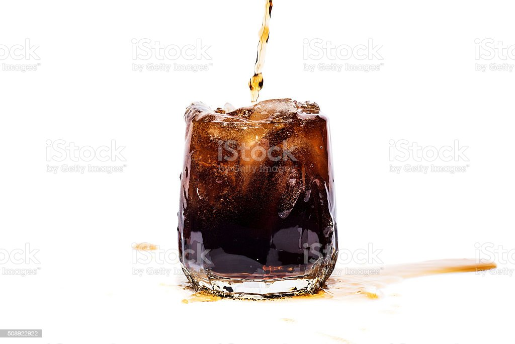 Glass of cola with ice cubes isolate stock photo