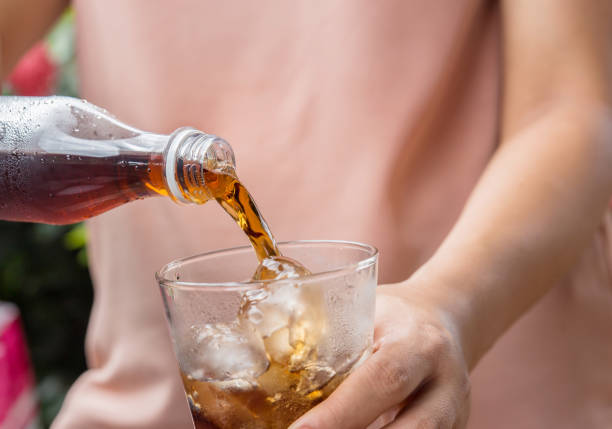 glass of cola with ice cubes. - soda pop stock photos and pictures