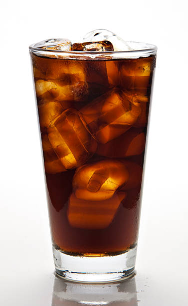 glass of cola with ice stock photo