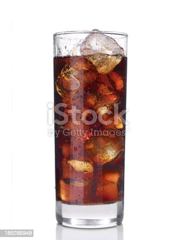 glass of cola with ice isolated on white background.