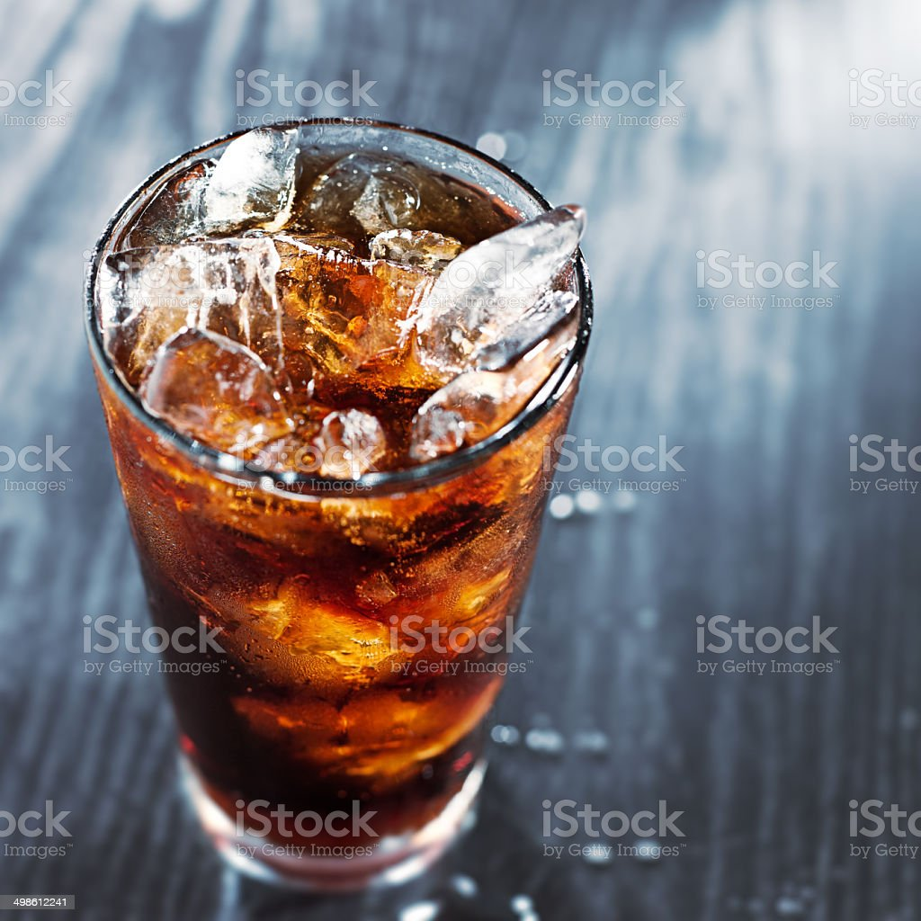 glass of cola with ice with copyspace in composition stock photo