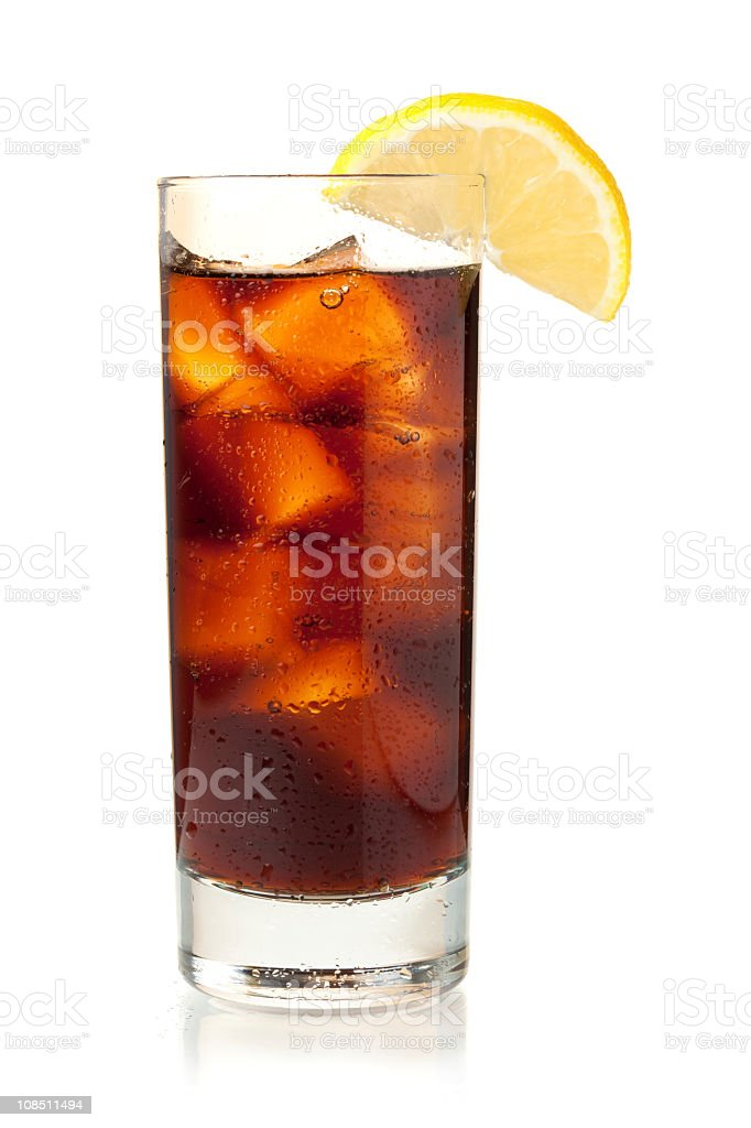 Glass of cola with slice of lemon on white surface royalty-free stock photo