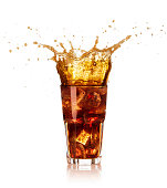 glass of ice and cola with big splash isolated on white background