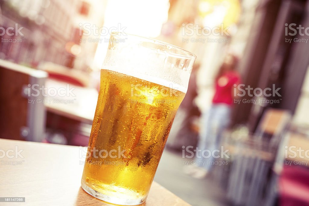 Glass of cold beer outside a pub stock photo