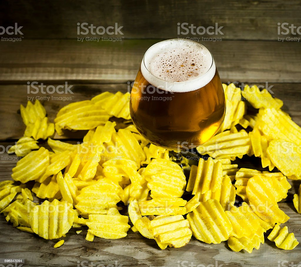 Glass of cold beer with chips royalty-free stock photo