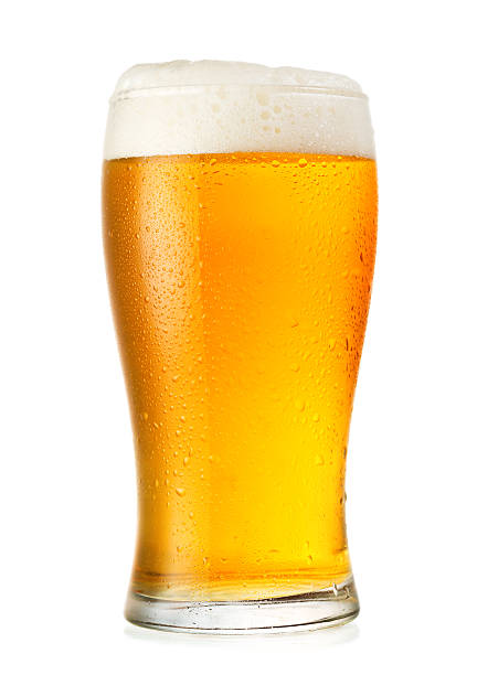 Glass of cold beer with condensation glass of beer isolated on white background beer glass stock pictures, royalty-free photos & images