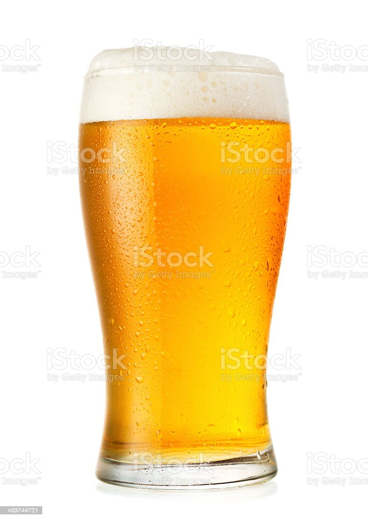 Glass of cold beer with condensation stock photo