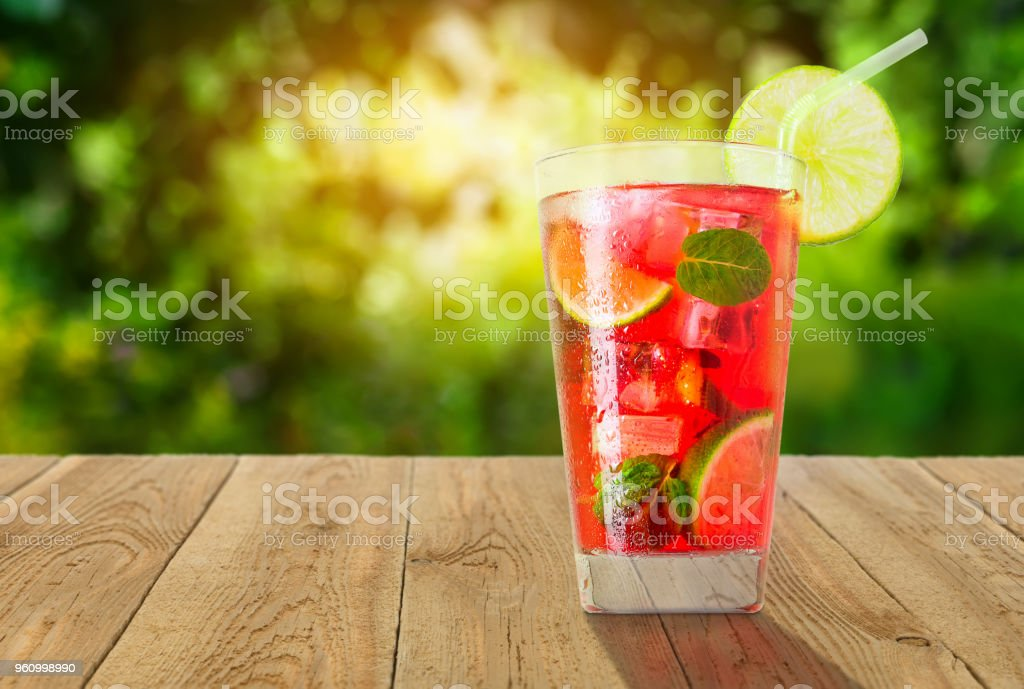 glass of cold red cocktail stock photo
