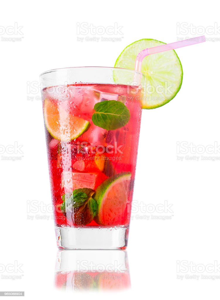 glass of cold red cocktail with straw isolated on white royalty-free stock photo