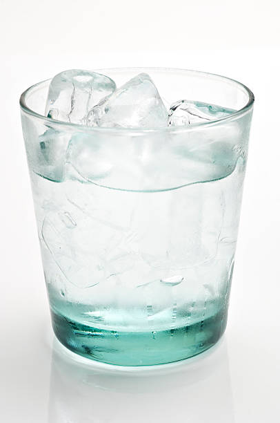 glass of cold water with ice cubes stock photo