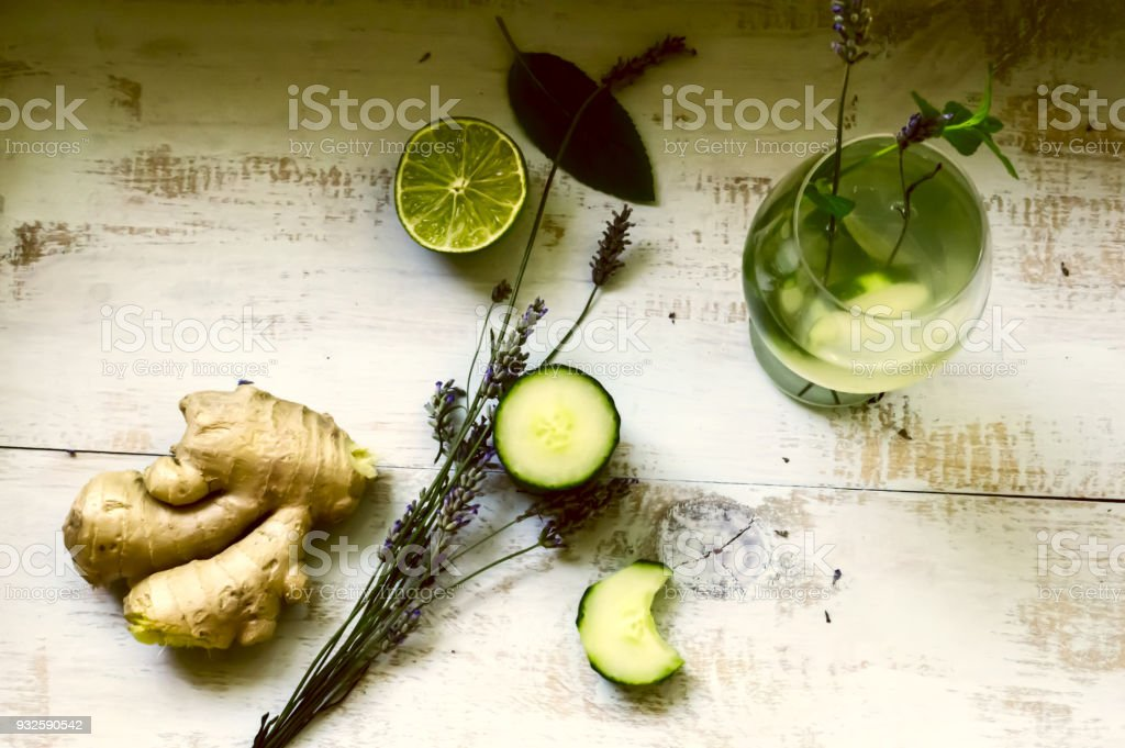 Glass of Cucumber water and Green healthy food ingredients  on rustic wood background photography flat lay stock photo