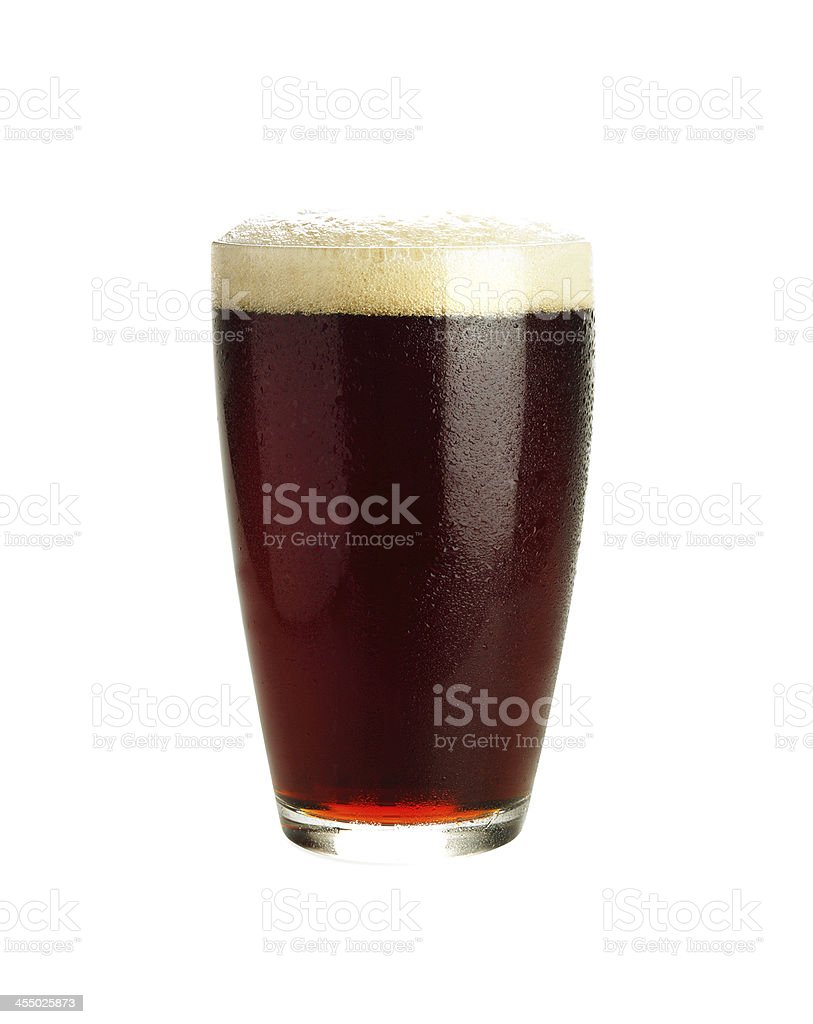 Glass of dark beer isolated on white stock photo