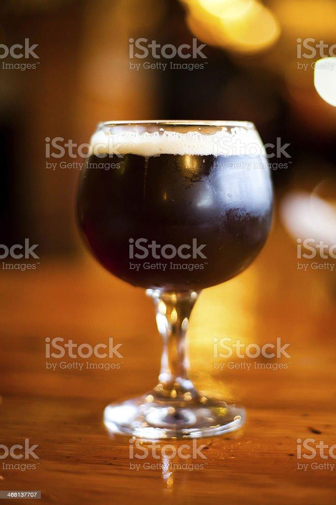Glass of dark beer. stock photo