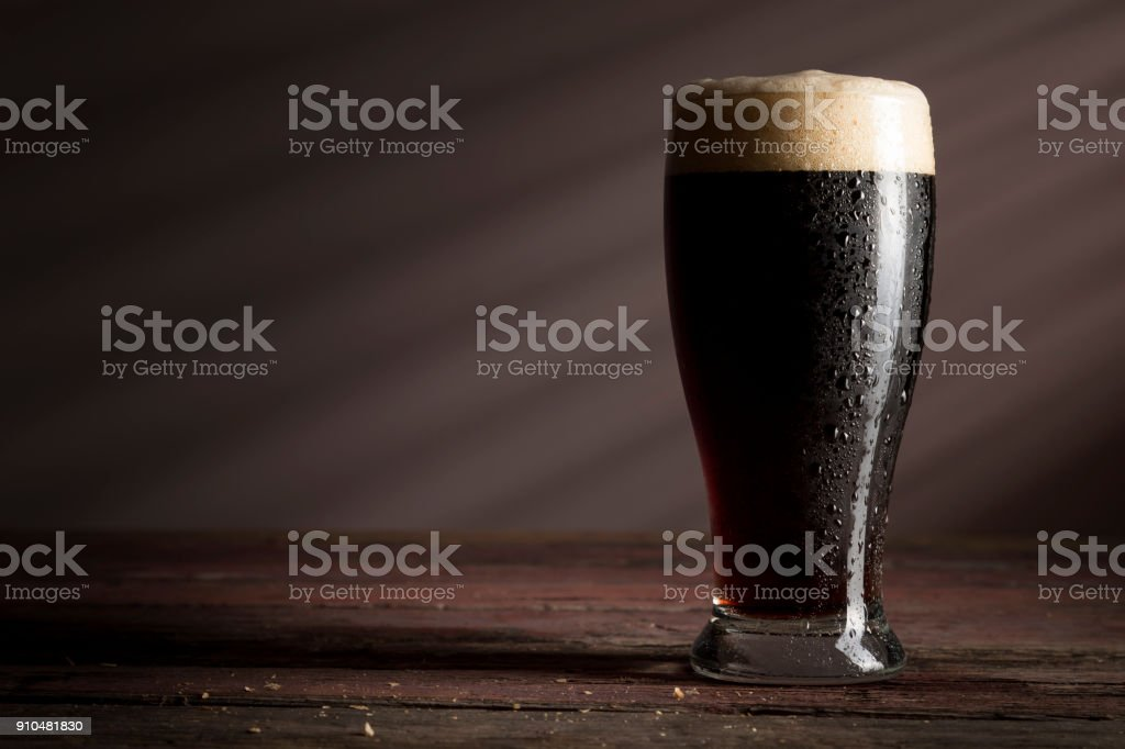 Glass of dark beer stock photo