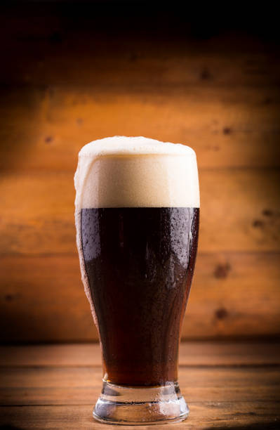 Glass of dark beer Glass of dark beer bitter ale stock pictures, royalty-free photos & images