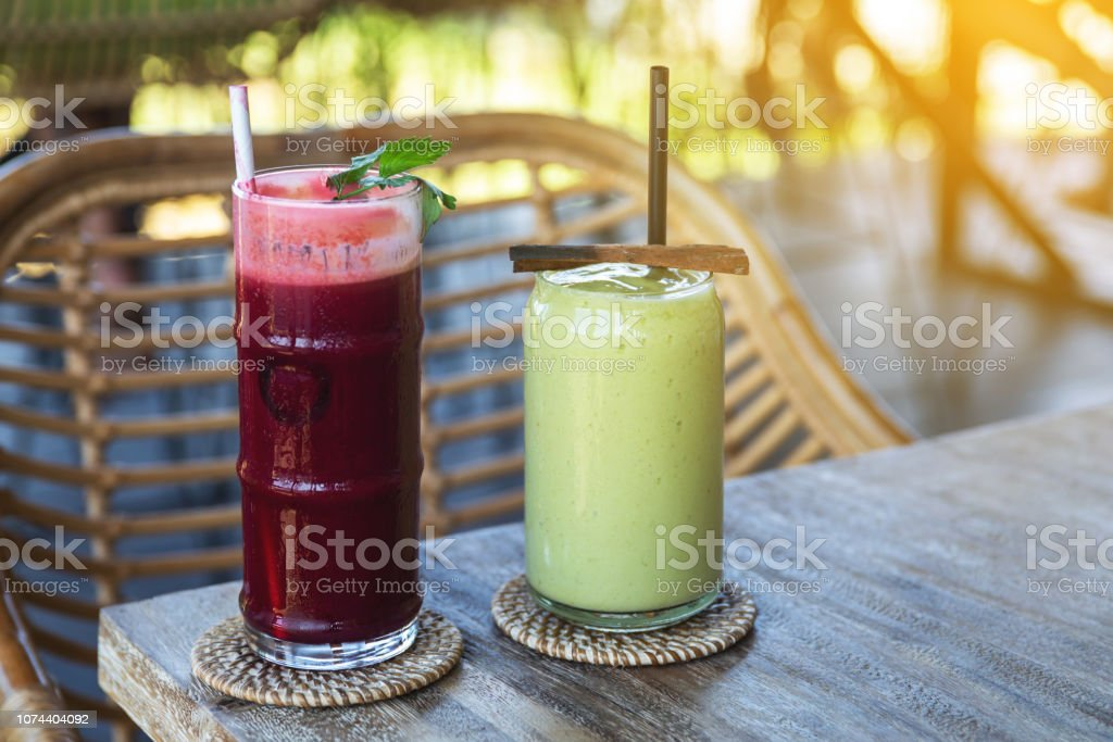 Glass of delicious beetroot juice and healthy avocado smoothie stock photo