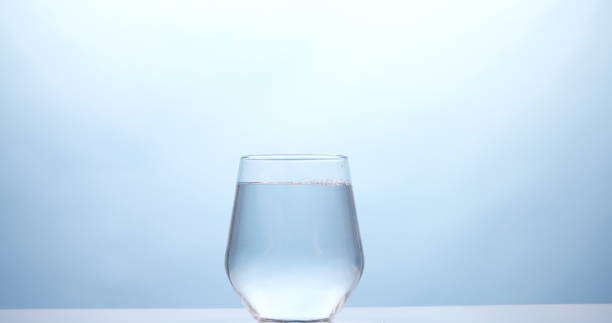 Glass of drinking water stock photo