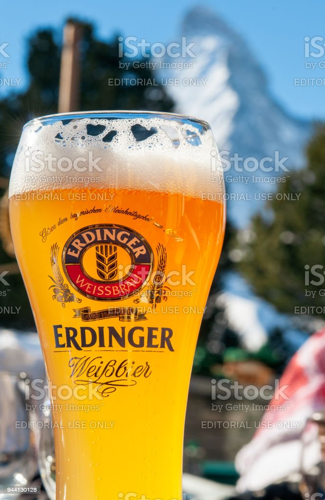 A glass of Erdinger beer in front of the Matterhorn stock photo