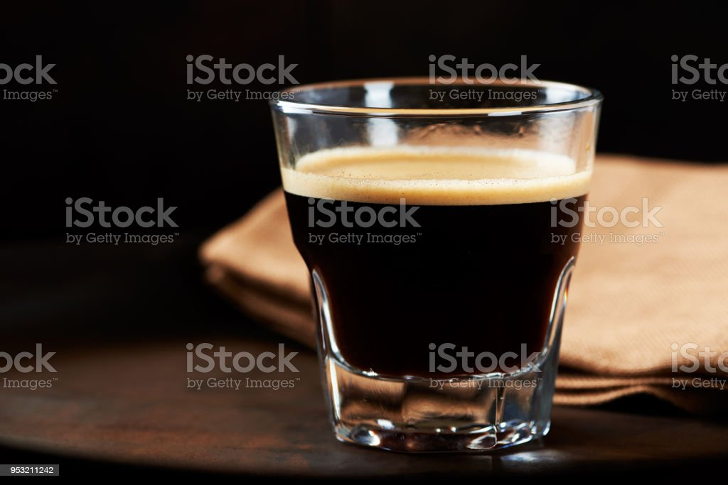 Glass of Espresso on dark background. stock photo