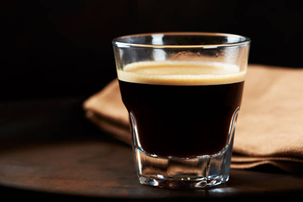 Glass of Espresso on dark background. Glass of Espresso on dark background. black coffee stock pictures, royalty-free photos & images