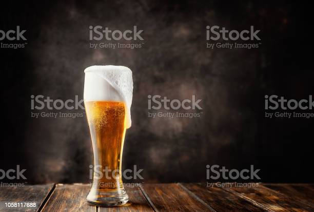 Glass of fresh and cold beer on dark background picture id1058117688?b=1&k=6&m=1058117688&s=612x612&h=1zwwllir ipqggnxb d7e6uekwhusikhjhutgj uto4=