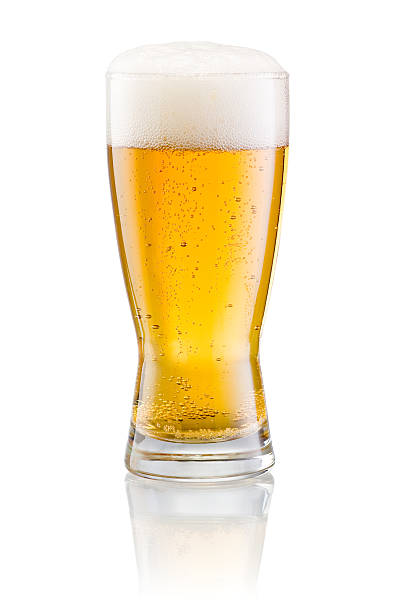 Glass of fresh beer with cap foam isolated on white Glass of fresh beer with cap of foam isolated on white background lager stock pictures, royalty-free photos & images