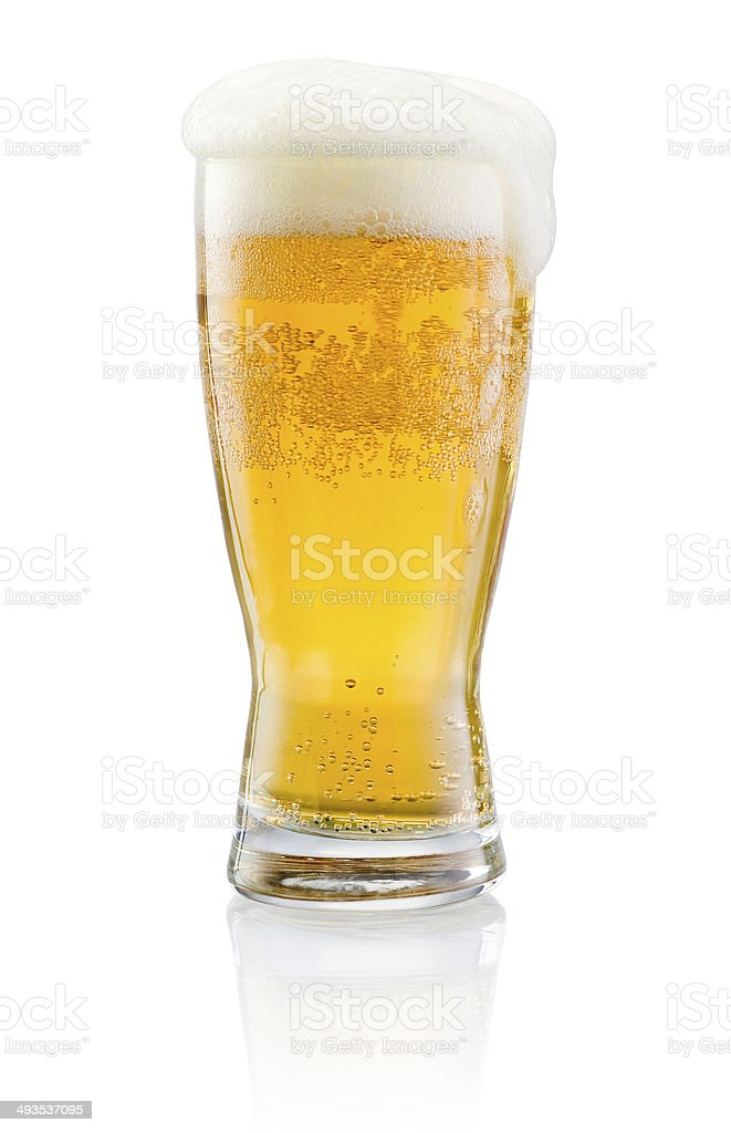 Glass of fresh beer with cap of foam isolated stock photo