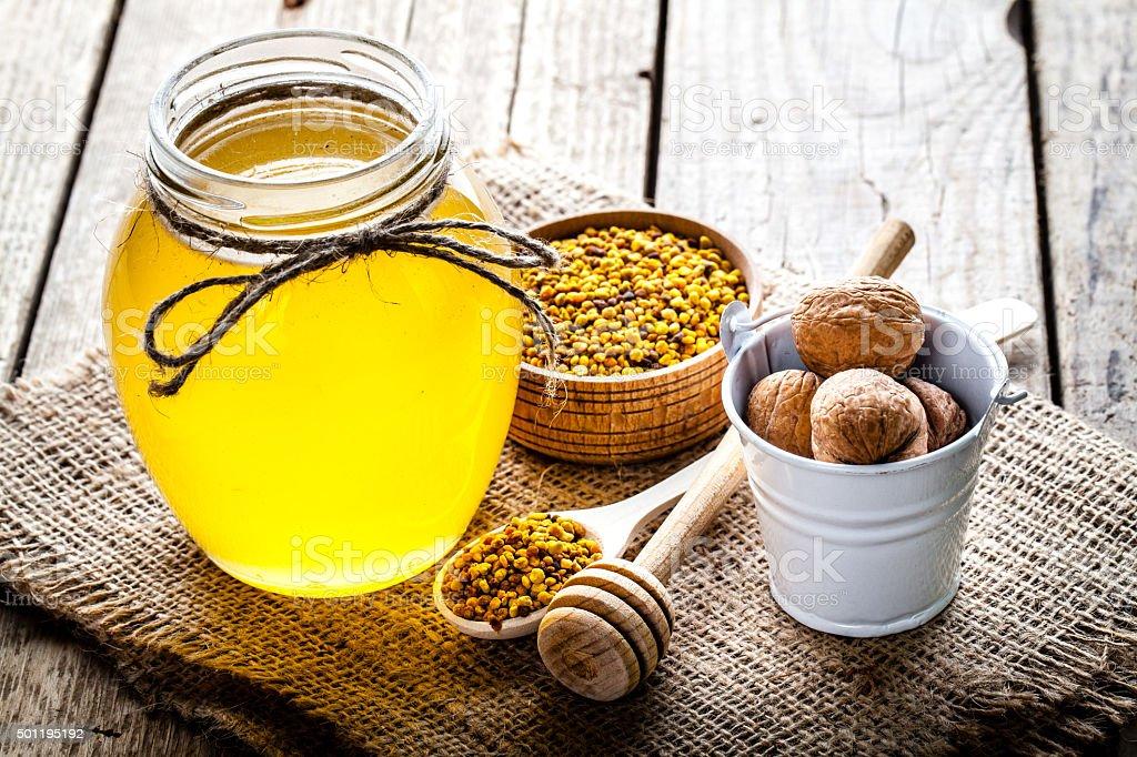 glass of fresh honey isolated stock photo