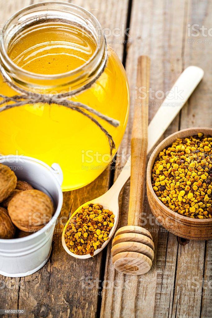 glass of fresh honey stock photo