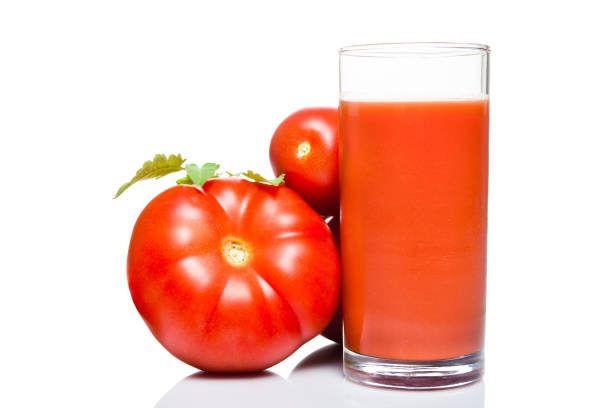 Glass of fresh tomato juice isolated on white background Glass of fresh tomato juice and tomatoes isolated on white background vegetable juice stock pictures, royalty-free photos & images