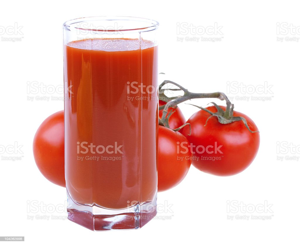 Glass of fresh tomato juice with tomatoes royalty-free stock photo
