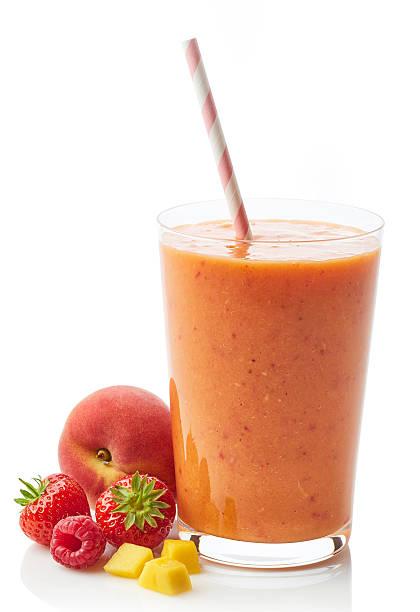 glass of fruit and berry smoothie - pfirsich milchshake stock-fotos und bilder