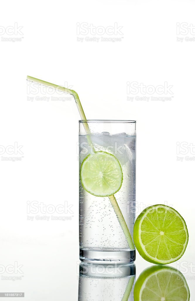 Glass of gin and tonic with lime royalty-free stock photo