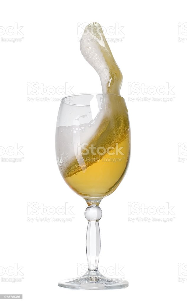 Glass of golden cold beer stock photo