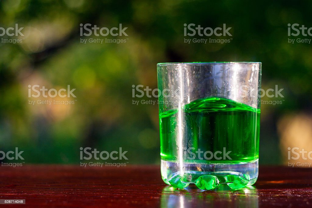 Glass of green absinth stock photo